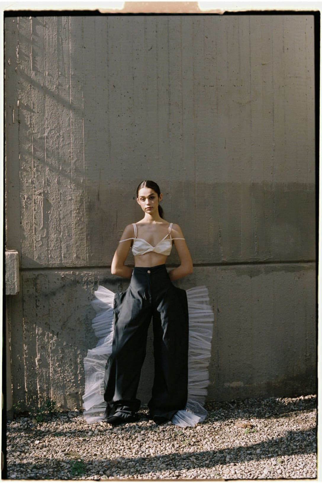 top by JACQUEMUS, trousers by PETER SPOSITO STUDIO